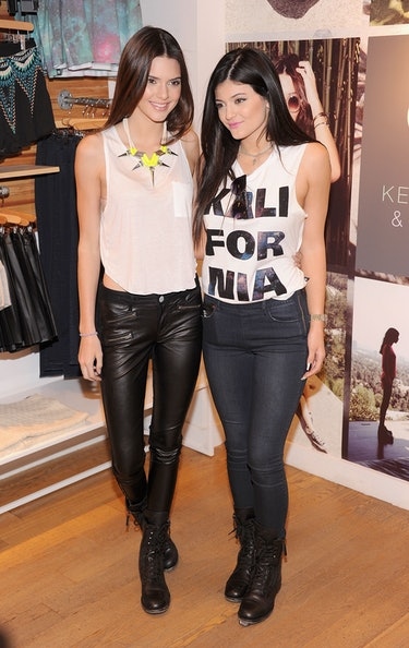 """NEW YORK, NY - AUGUST 06:  Kendall Jenner and  Kylie Jenner attend """"Kendall And Kylie"""" Fall Collection Preview at PacSun NYC Pop Up Shop on August 6, 2013 in New York City.  (Photo by Jamie McCarthy/Getty Images)"""
