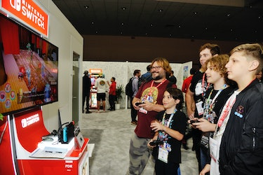 LOS ANGELES, CALIFORNIA - JUNE 12: Jack Black (L) and family check out 'Marvel Ultimate Alliance 3: The Black Order' for the Nintendo Switch system during the 2019 E3 Gaming Convention at Los Angeles Convention Center on June 12, 2019 in Los Angeles, California. (Photo by John Sciulli/Getty Images for Nintendo)