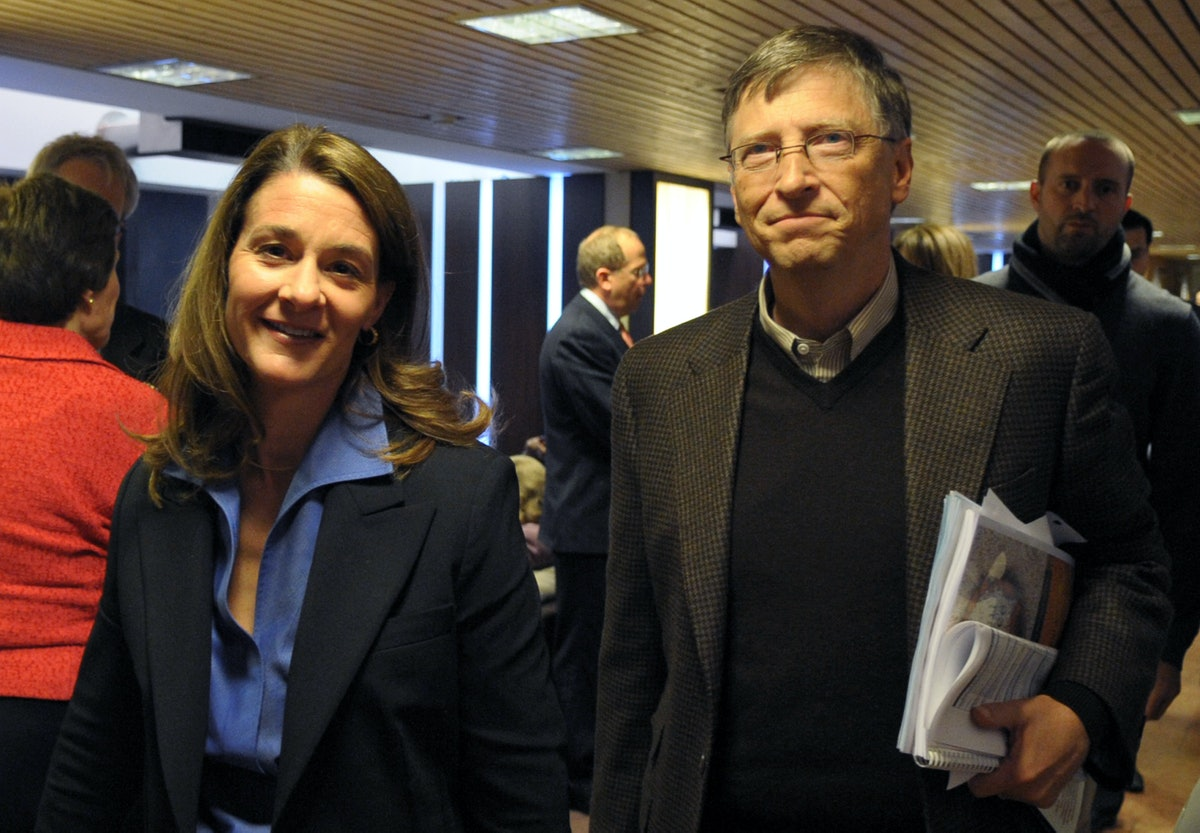 Bill and Melinda Gates walk in the Congress center at the World Economic Forum on January 29, 2010 i...