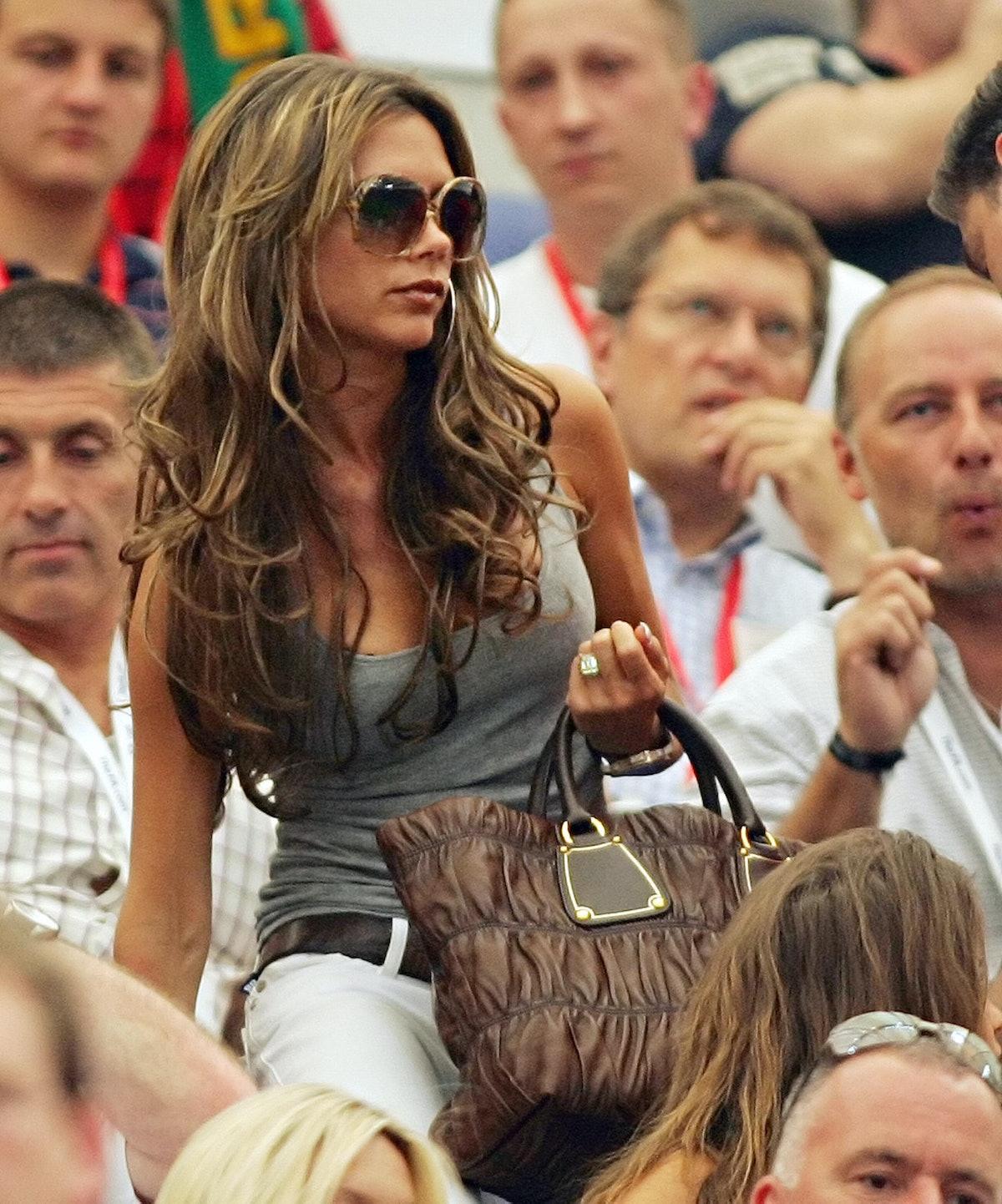 Victoria Beckham, wife of English midfielder David Beckham, arrives in the tribune prior to the Worl...