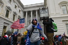 Supporters of US President Donald Trump protest as they storm the US Capitol on January 6, 2021, in ...