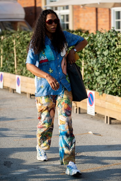Guest wearing colorful pants and shirt during Copenhagen fashion week SS21