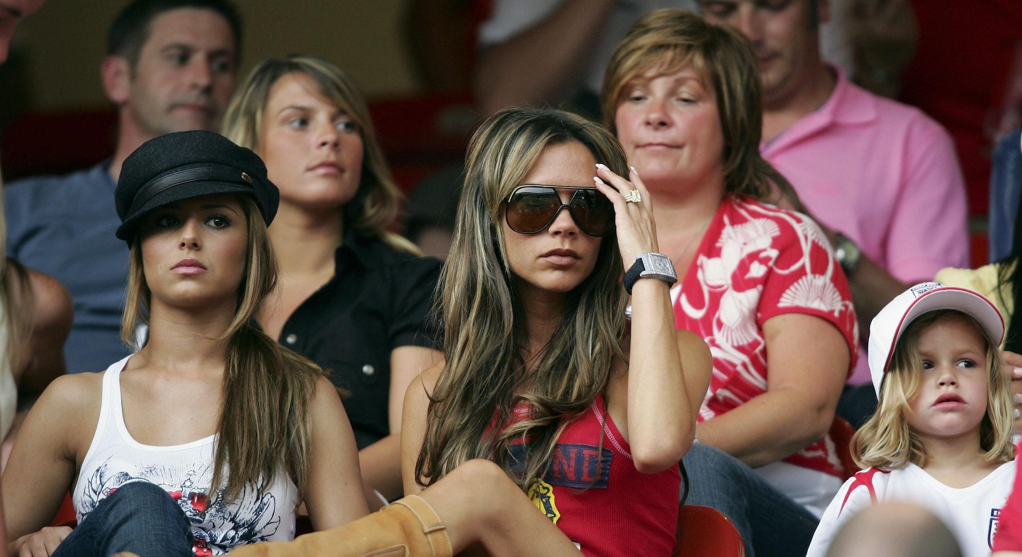 NUREMBERG, GERMANY - JUNE 15:  (L to R) Singer Cheryl Tweedy the girlfriend of Ashley Cole, Victoria...
