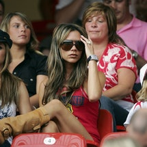 NUREMBERG, GERMANY - JUNE 15:  (L to R) Singer Cheryl Tweedy the girlfriend of Ashley Cole, Victoria Beckham the wife of England Captain David Beckham, and their son, Romeo attend the FIFA World Cup Germany 2006 Group B match between England and Trinidad and Tobago at the Frankenstadion on June 15, 2006 in Nuremberg, Germany.  (Photo by Ross Kinnaird/Getty Images)