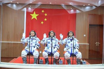 JIUQUAN, CHINA - JUNE 17: (L-R) Astronauts Tang Hongbo, Nie Haisheng and Liu Boming attend a see-off...