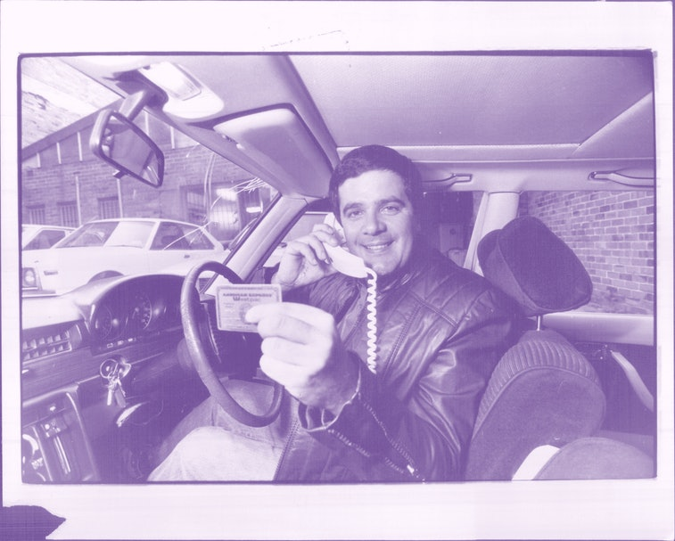 """Simon Townsend, seen here with his """"Gold Bank Card"""", and """"Car Phone"""". May 31, 1983. (Photo by Philip..."""