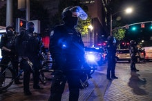 PORTLAND, OR - APRIL 20: Portland police stand guard as tensions rise with a small group of proteste...