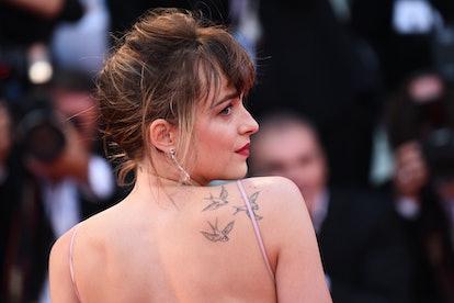 Dakota Johnson curtain bangs french twist updo