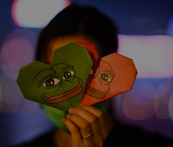 TOPSHOT - This picture taken on September 30, 2019 shows a protester holding origami hearts with a depiction of Pepe the Frog, a character used by pro-democracy activists as a symbol of their struggle, by the waterfront along Victoria Harbour in Hong Kong's Tim Sha Tsui district. - He may have become a far-right internet meme in the West, but Pepe the Frog's image is being rehabilitated in Hong Kong where democracy protesters have embraced him as an irreverent symbol of their resistance. (Photo by Mohd RASFAN / AFP) / TO GO WITH AFP STORY HONG KONG-CHINA-POLITICS-UNREST-PEPE,FOCUS BY INDIA BOURKE (Photo by MOHD RASFAN/AFP via Getty Images)