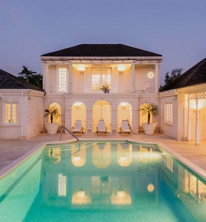 a white villa with a geometric pool