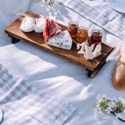 A cheese board and linens help create an Instagram-worthy picnic.