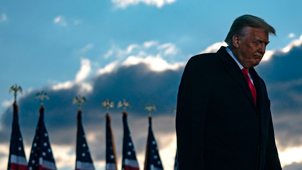 Outgoing US President Donald Trump addresses guests at Joint Base Andrews in Maryland on January 20, 2021. - President Trump and the First Lady travel to their Mar-a-Lago golf club residence in Palm Beach, Florida, and will not attend the inauguration for President-elect Joe Biden. (Photo by ALEX EDELMAN / AFP) (Photo by ALEX EDELMAN/AFP via Getty Images)