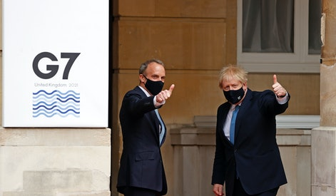 LONDON, ENGLAND - MAY 05: British Prime Minister Boris Johnson and British Foreign Secretary Dominic Raab pose for photographs as they arrive for the G7 foreign ministers' meeting on May 5, 2021 in London, England. Representatives from G7 countries are meeting face-to-face for the first time in two years, ahead of the G7 Leaders' Summit to be held in June. (Photo by Adrian Dennis - WPA Pool/Getty Images)