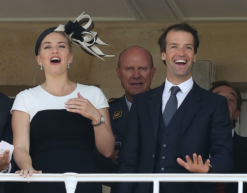 CHANTILLY, FRANCE - JUNE 15:  (EDITORS NOTE: Retransmission of #450654896 with alternate crop.) Actress Kate Winslet and husband Ned Rocknroll attend the 'Prix de Diane Longines 2014' at Hippodrome de Chantilly on June 15, 2014 in Chantilly, France.  (Photo by Marc Piasecki/Getty Images)
