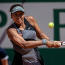 Osaka Naomi of Japan returns the ball during the women's singles first round match against Patricia ...