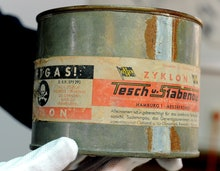 An archive employee holds a can of Zyklon B poison gas at the former Inspectorate of the Concentrati...