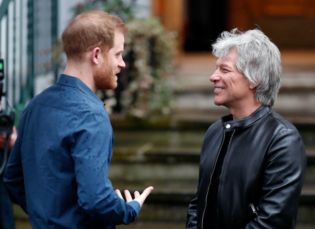 Prince Harry, Duke of Sussex meets Jon Bon Jovi at the Abbey Road Studios where the Invictus Games C...