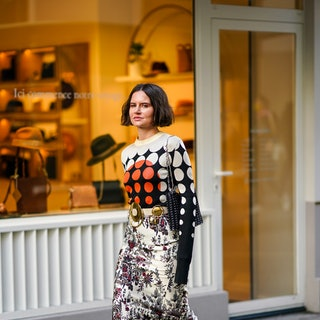 PARIS, FRANCE - OCTOBER 04: Marta Cygan wears a wool pullover with printed black orange and white do...