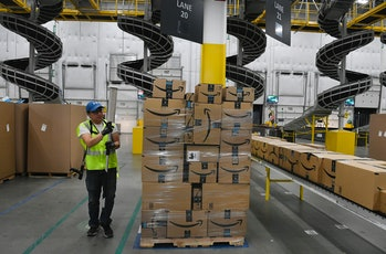 THORNTON, CO - FEBRUARY 19: Billie Her, a warehouse associate, wraps plastic around a pallet of boxe...