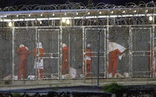 (FILES) This file photo shows detainees as they prepare themselves for the evening prayer 04 March 2...