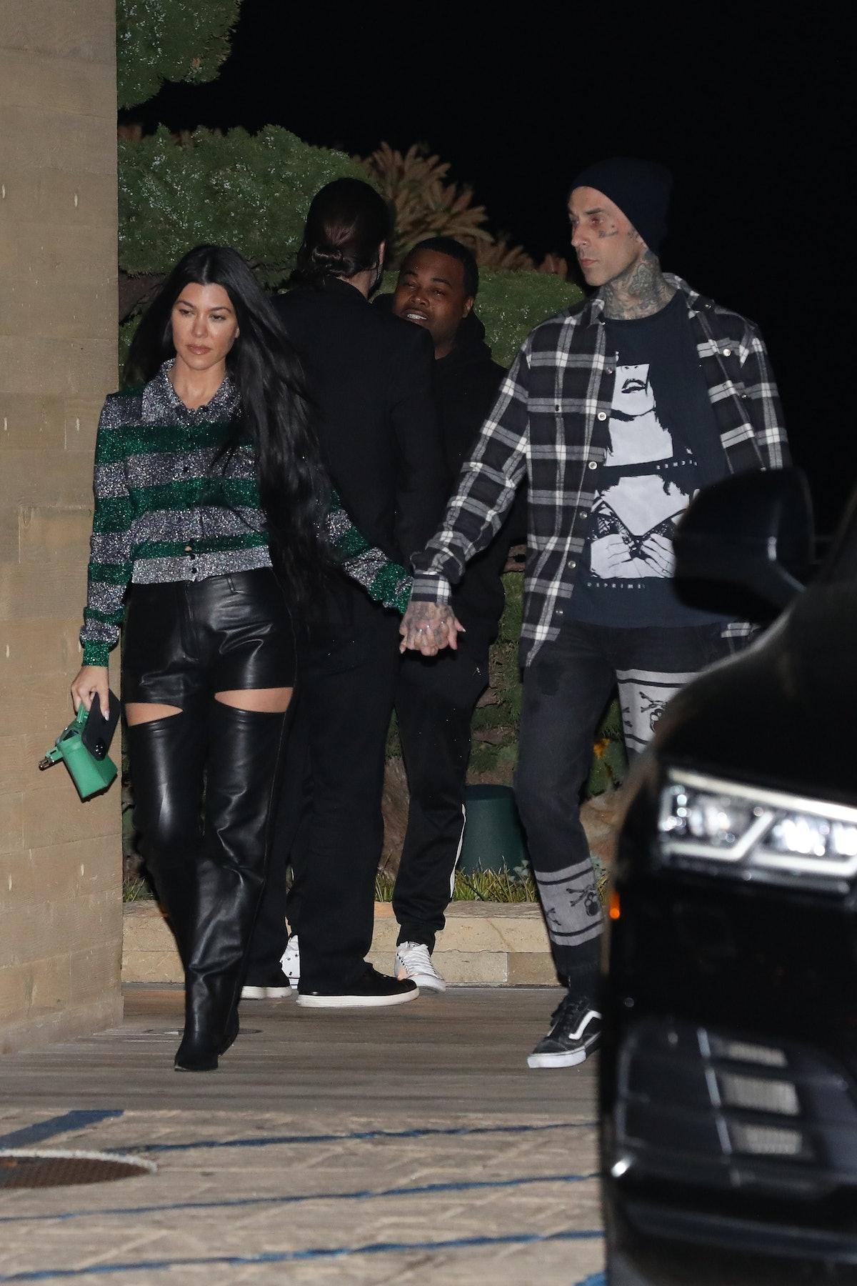 MALIBU, CA - MARCH 20: Kourtney Kardashian and Travis Barker are seen at Nobu restaurant on March 20...