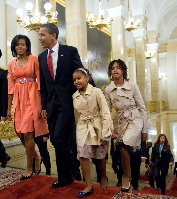 US President Barack Obama, his wife Michelle and their daughters Sasha and Malia walk through the Kr...