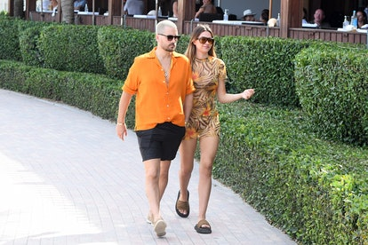 Scott Disick and Amelia Hamlin are seen walking at the beach on April 7, 2021 in Miami, Florida.