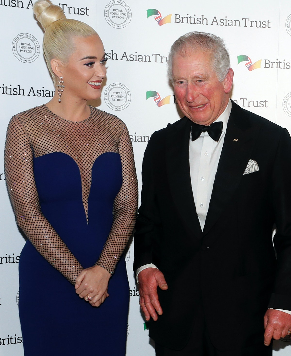 Prince Charles, Prince of Wales, Royal Founding Patron of the British Asian Trust poses with musicia...
