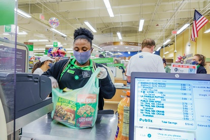 Florida, Miami Beach, Publix, supermarket check out cashier during Coronavirus Pandemic. On May 27, ...