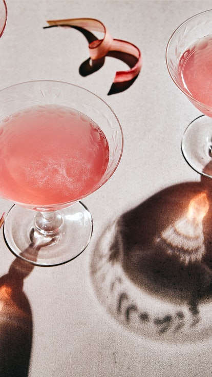 3 glasses of rhubarb sparkling mocktail or wine on grey table with dark shadows