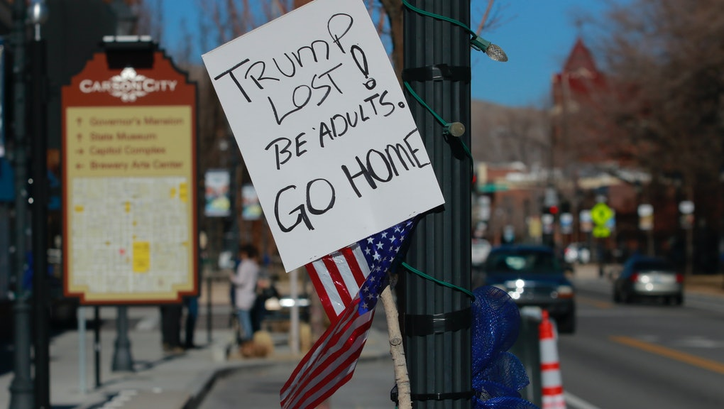 A sign left by an anti-protestor is shown near the Nevada State Legislature on January 17, 2021, in ...