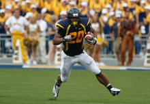 MORGANTOWN, WV - SEPTEMBER 01:  Shawne Alston #20 of the West Virginia Mountaineers carries the ball...