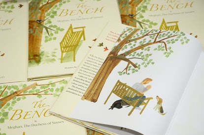 """LONDON, ENGLAND - JUNE 08: A illustration of a father and son are seen inside a copy of Meghan Markle's book """"The Bench"""" on a display in Europe's largest bookstore Waterstones Piccadilly, on June 08, 2021 in London, England. The book comes just days after Meghan and Harry, the Duchess and Duke of Sussex, announced the birth of their daughter Lilibet Diana Mountbatten-Windsor. (Photo by Leon Neal/Getty Images)"""