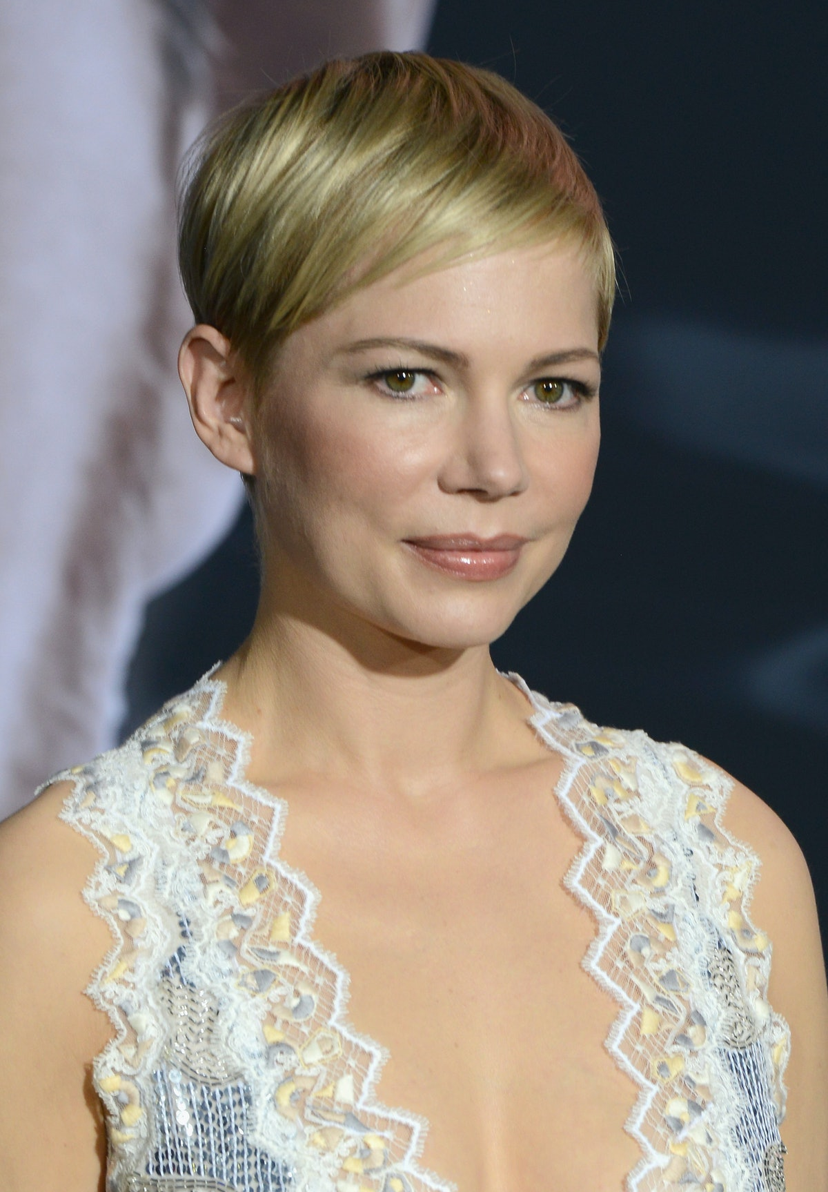 Michelle Williams sports her iconic pixie cut at the premiere of Venom.