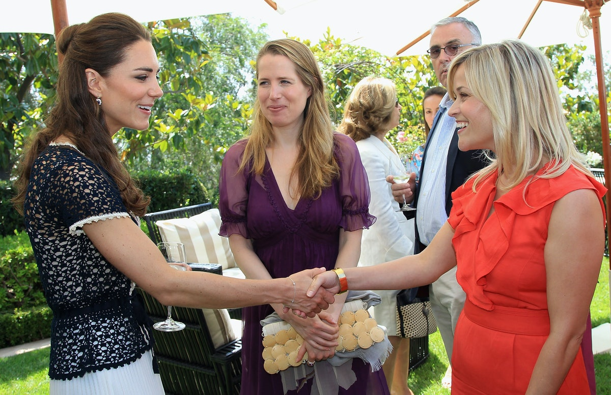 Catherine, Duchess of Cambridge meets actress Reese Witherspoon as she attends a reception to mark t...