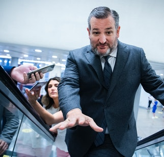 UNITED STATES - MAY 25: Sen. Ted Cruz, R-Texas, warns the photographer about the end of the escalator in the senate subway during a vote on Tuesday, May 25, 2021. (Photo By Tom Williams/CQ-Roll Call, Inc via Getty Images)