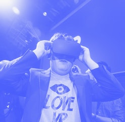 """Palmer Luckey, Oculus founder,  tries on the Oculus Rift  after an Oculus VR news conference """"Step into the Rift' at Dogpatch Studios on Thursday, June 11, 2015 in San Francisco, Calif. (Photo By Lea Suzuki/The San Francisco Chronicle via Getty Images)"""