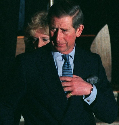 The heir to the British throne, Prince Charles (R) and his long time mistress Camilla Parker Bowles ...