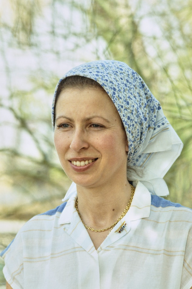 British Royal Princess Anne, Princess Royal wearing a blue floral print headscarf, during a visit to...