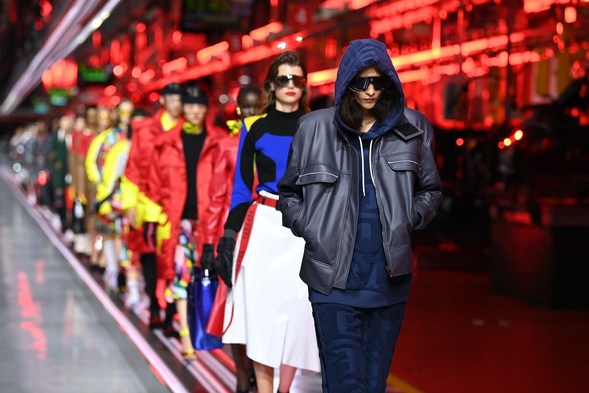 MARANELLO, ITALY - JUNE 13: A model walks the runway at the fashion debut of the first co-ed Ferrari...