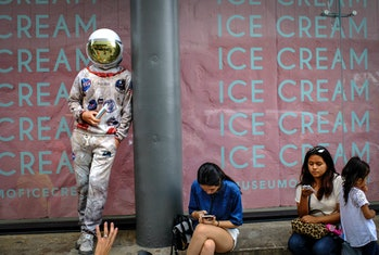 NEW YORK, NY - JULY 29: A man dress up as astronaut stands outside the new Museum of Ice Cream acros...