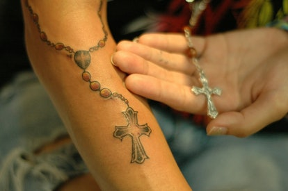 Some tattoo artists consider inverted cross tattoos to be bad luck. If you get one on your forearm, like here, be careful about placement.