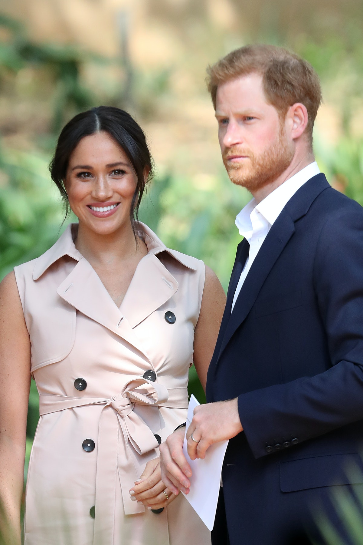 Prince Harry, Duke of Sussex and Meghan, Duchess of Sussex — shown here outdoors — purchased website...