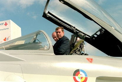 PA NEWS PHOTO 8/9/98 Prince Andrew, the Duke of York, right, sits at the controls of the new Typhoon...