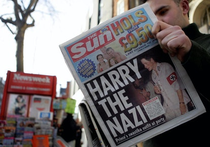 """LONDON, UNITED KINGDOM:  A man reads the newspaper """"The Sun"""" in London 13 January, 2005 with a headl..."""