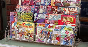 """Spokane, Washington, USA - August 25, 2012: Assortment of popular comic books for sale outside of a comic book shop in downtown Spokane, Washington."""
