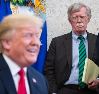 WASHINGTON, DC - MAY 17: National Security Advisor John Bolton listens as President Donald J. Trump speaks with NATO Secretary General Jens Stoltenberg during a meeting in the Oval Office at the White House on Thursday, May 17, 2018 in Washington, DC. (Photo by Jabin Botsford/The Washington Post via Getty Images)