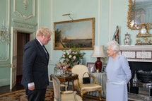 Britain's Queen Elizabeth II greets Britain's Prime Minister Boris Johnson during an audience at Buc...