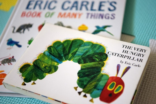 """This photo illustration taken on May 26, 2021 shows Eric Carle's """"The Very Hungry Caterpillar"""" and """"..."""