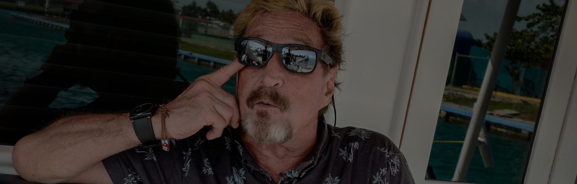 US millionaire John McAfee gestures during an interview with AFP on his yacht anchored at the Marina...